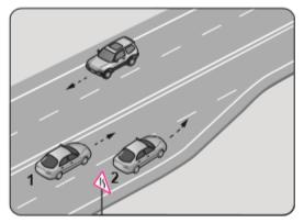 Şekle göre 2 numaralı aracın sürücüsü ne yapmalıdır?